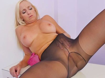 Canadian milf Dani Dare fingers her holes in nylon