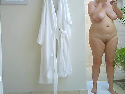 voyeur MILF showering and dressing