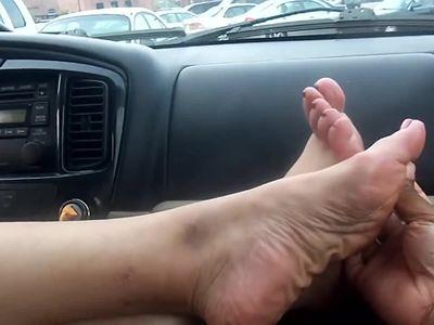 Sexy mature feet in car...