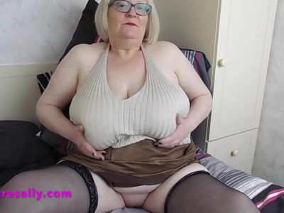 Horny Granny with big tits and shaved pussy