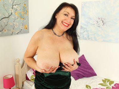 English and big titted milf Sabrina needs a dildo fucking