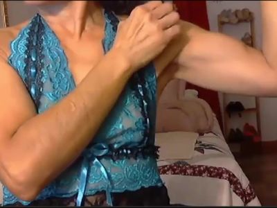Latina granny flexex her calves and biceps