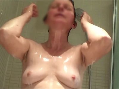tits a gogo - unaware milf in shower
