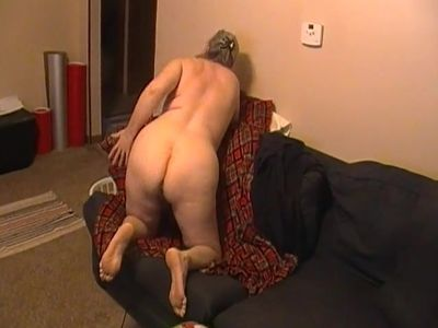 Kim Bates fingers her ass and hairy pussy. Care to join her?