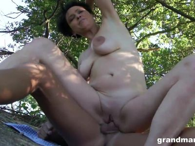 Horny mature taken advantage of by the lake by 2 young guys