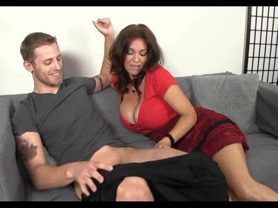 Busty mature sucks young cock