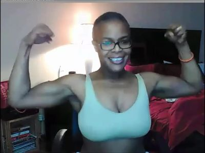 Pretty black MILF flexes her big muscles