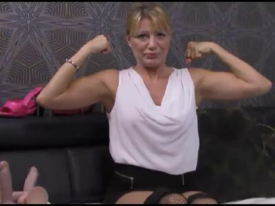 Pretty Russian MILF flexes her biceps on cam