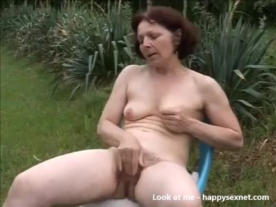 Horny hairy mature masturbating in garden. Amateur