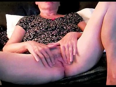 GILF shows her wet juicy pussy