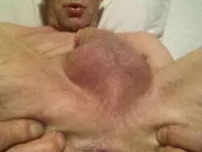 naked male spreading asshole wide open and fingering hole close up