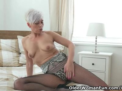 Euro milf Kathy White fingers her pussy in nylon