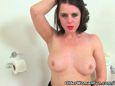 English milf Karina masturbates furiously on toilet