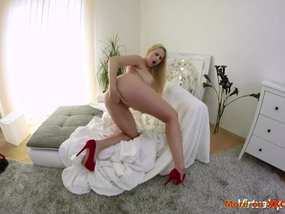 Busty blonde masturbates in front of camera