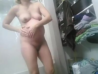 Hot pregnant blonde wife getting into shower