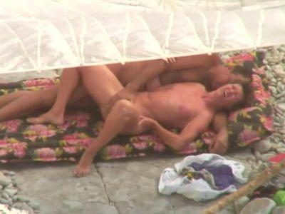 Sex on the beach.   Mature fucking on beach.