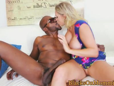 Mature beauty facialized by two black dicks