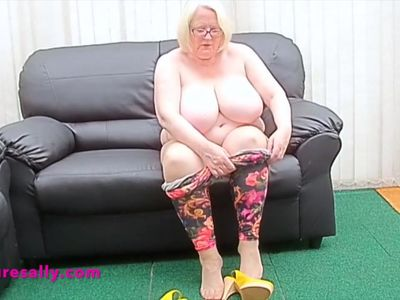 Slutty Sally masturbates on her sofa