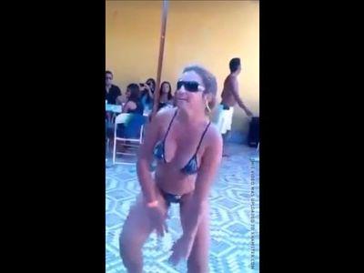 Mature dancing in family resort