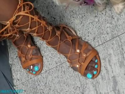 Candid mature lady in viking sandals