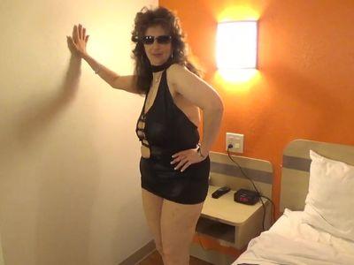 Tinja Stretches A Black Mini Dress
