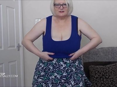 Blue tank top, short skirt and boots