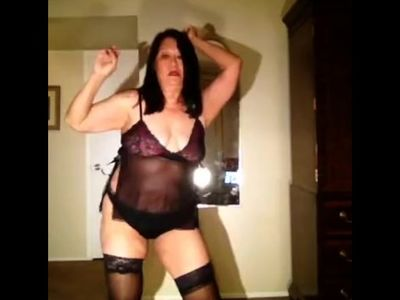 mature Latina granny dancing in her thong and thigh high nylons