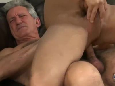 Old Grandpa pounds a twink then showers him with cum