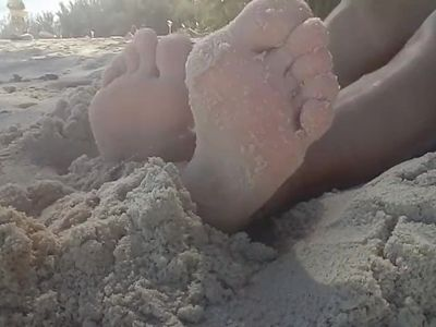 Footfetish on the beach.