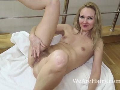 Foxy masturbates after sliding off her white robe