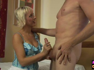 Randy mature blonde tugs on cfnm cock