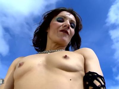 Mature brunette Heloise Dacosta doing a strip by the sea