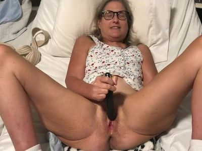 Milf in glasses spreads pussy and masturbates with black rabbit mature