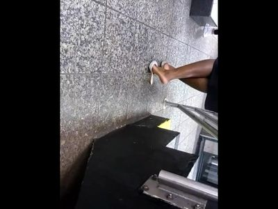Mature ebony woman shoeplay on the platform candid [NOT MY WORK!]