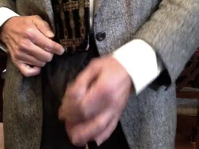 In my suit I gently rub my cock, pull it out and my cum starts flying every