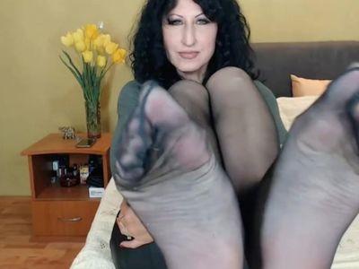 Mature shows big nylon feet on webcam