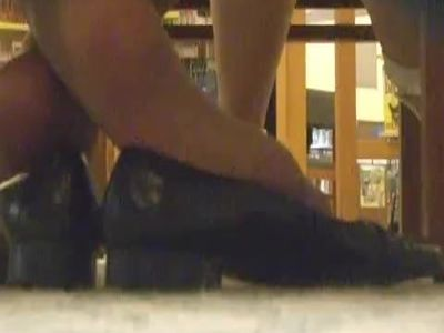 CROSSED ANKLE DIPPING IN LIBRARY